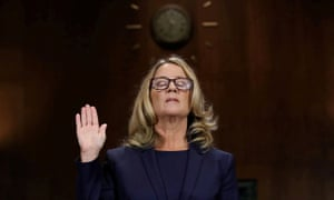 Christine Blasey Ford is sworn in before testifying at the Senate judiciary committee on Thursday.