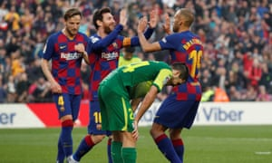 Braithwaite celebrates with Messi after setting up Barcelona's fourth goal in their 5-0 win over Eibar, having come off the bench to make his debut just two days after joining the club in February.