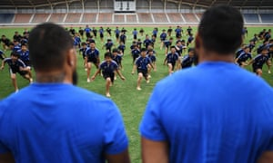 Japanese children perform a 'haka' in front of New Zealand players in Kashiwa.