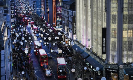 Shoppers walk in Oxford Street in London.