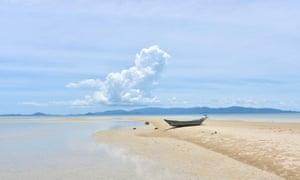 deserted kho phangan beach with one boat Thailand