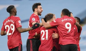 The United players celebrate with goalscorer Luke Shaw.