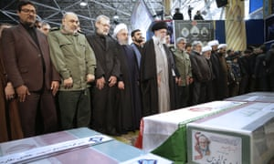 Ayatollah Khamenei, centre, leads a prayer in Tehran over the coffins of Qassem Suleimani and others killed in a US drone strike on Friday.