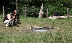 Photographers take pictures at the remains of Raoul Moat's campfire found by police on 7 July, 2010 in Rothbury.