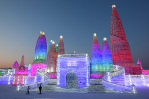 Preparation for the 34th Harbin International Ice and Snow Festival. People visit the ice sculptures illuminated by coloured lights at Harbin ice and snow world for the 34th Harbin International Ice and Snow Festival in Harbin city, China's northern Heilongjiang province, 04 January 2018.
