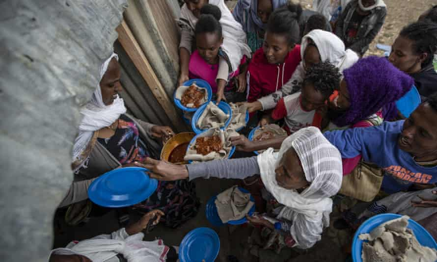 Displaced Tigrayans line up to receive food donated by local residents at a reception centre in Mekele, northern Ethiopia