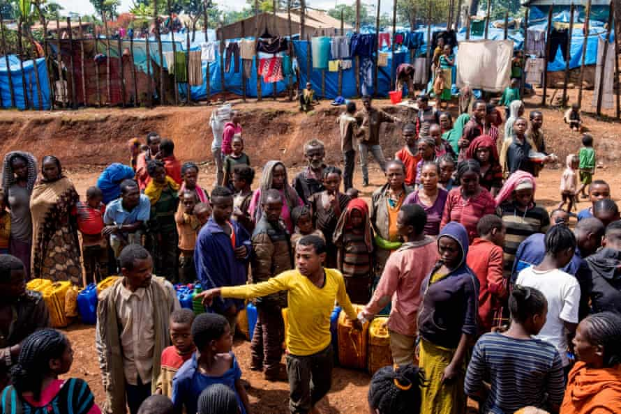 Displaced Gedeo people queue for water in West Guji, Ethiopia