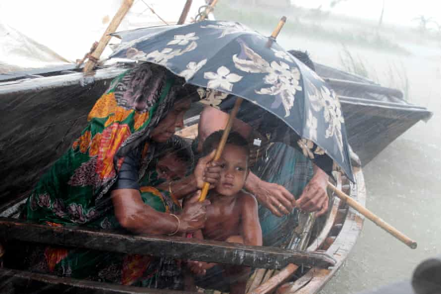 A woman sits with her child in a boat at a flooded village in Kurigram, July 2012