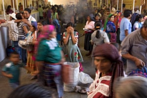 Women buy and sell at the weekly market in the south-western Mexican city of Tlacolula, where women now drive the local economy as the majority of men have emigrated to the US.