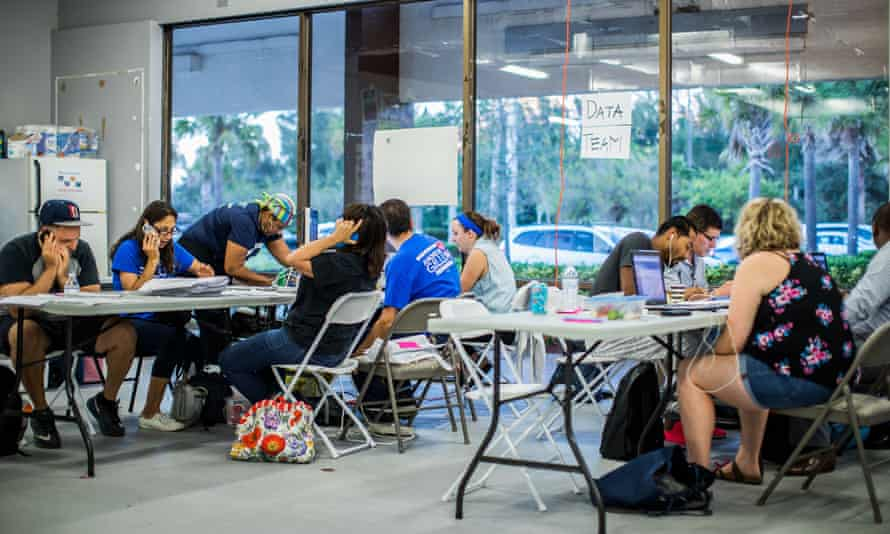 Volunteers in Florida count absentee and mail-in ballots.