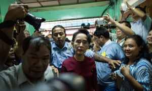 Aung San Suu Kyi arrives at the polling station in Yangon.