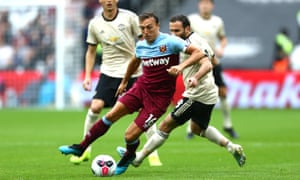 Mark Noble gets away from Manchester United's Juan Mata - his influence compared to that of the Spaniard was noticeable on Sunday.