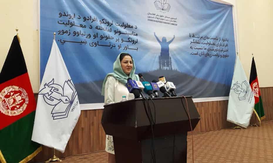 Blind Afghan human-rights activist Benafsha Yaqoobi speaking at a lectern