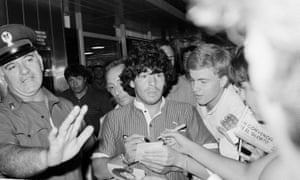 Diego Maradona thronged by fans after landing at Rome airport in July 1984, the month he signed for Napoli.