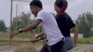Romance blossoms on the railway track … a still from I Love You, by ClassiQ ft Avala (Rahma Sadau).