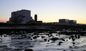 The sun sets behind Hinkley Point B and Hinkley Point A nuclear power stations.