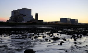 The sun sets behind EDF's Hinkley Point B, and (right) Hinkley Point A nuclear power stations.