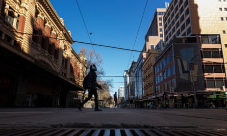 People exercise on Flinders Street in central Melbourne on Sunday