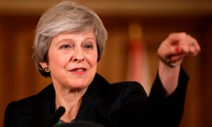 Theresa May takes questions from reporters during a press conference on Wednesday evening