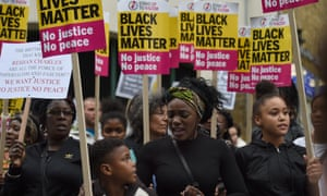 Members from Hackey Stand Up To Racism protest outside Stoke Newington Police Station, London, as the police watchdog launched an investigation after young black man Rashan Charles died in a shop after being chased by police.