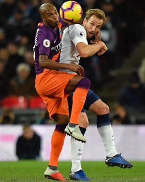 Manchester City's Fernandinho gets to grips with Spurs' Harry Kane.