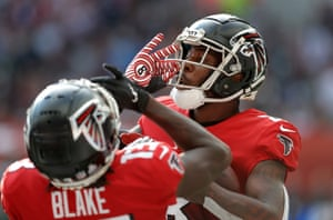 The Falcons tight end Kyle Pitts celebrates scoring the opening touchdown.