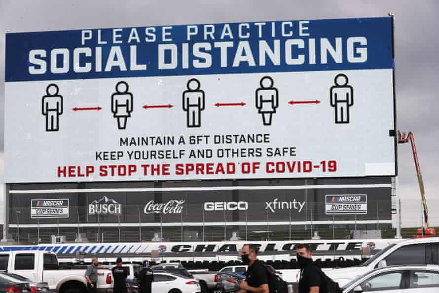A screen displays a message urging social distancing before a Nascar race in Concord, North Carolina, on 25 May.