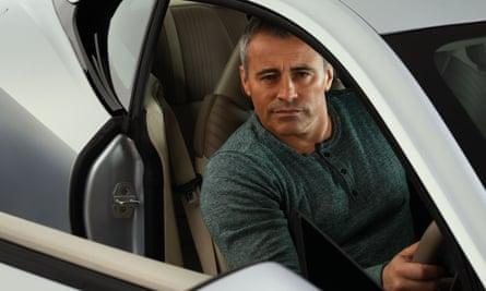 Matt LeBlanc in the driving seat of a car