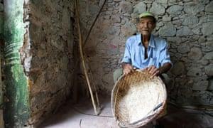 Leandro, a basket-maker originally from Cape Verde.