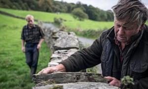 Farmers Raymond and Adam repair a wall in Cumbria