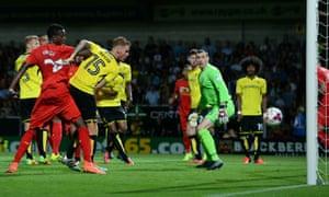 Burton Albion's Tom Naylor scores an own goal.