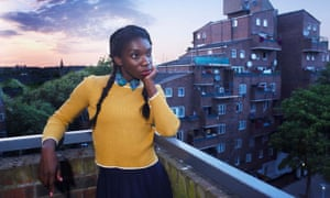 Michaela Coel in Chewing Gum standing on a balcony