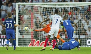 England's Marcus Rashford lets fly with a long-range effort to put his team 2-1 up against Slovakia in their World Cup qualifying match at Wembley.