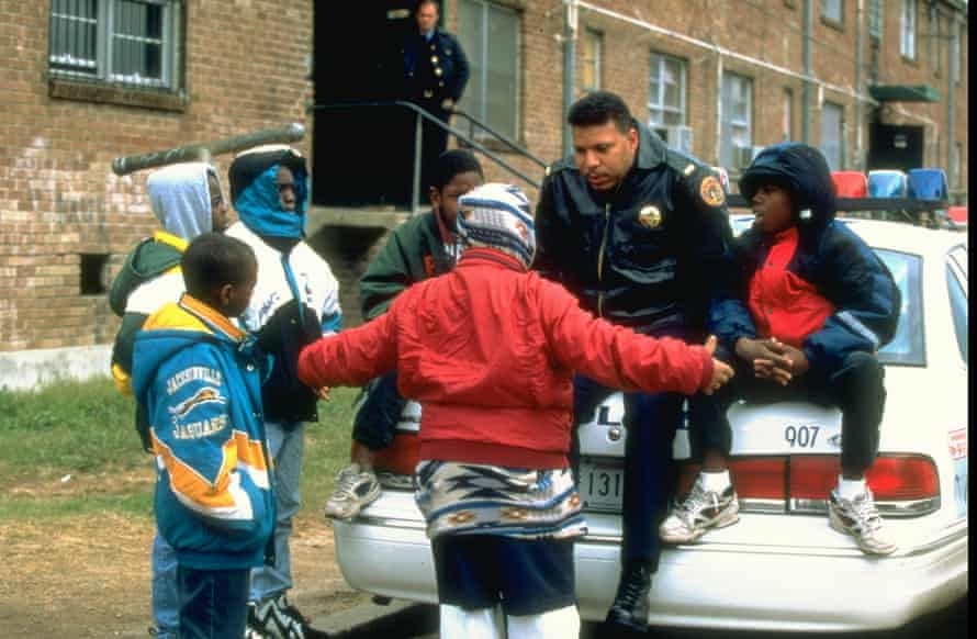 Desire housing project resident boys chatting up a police officer assigned to Community Oriented Policing Squa.