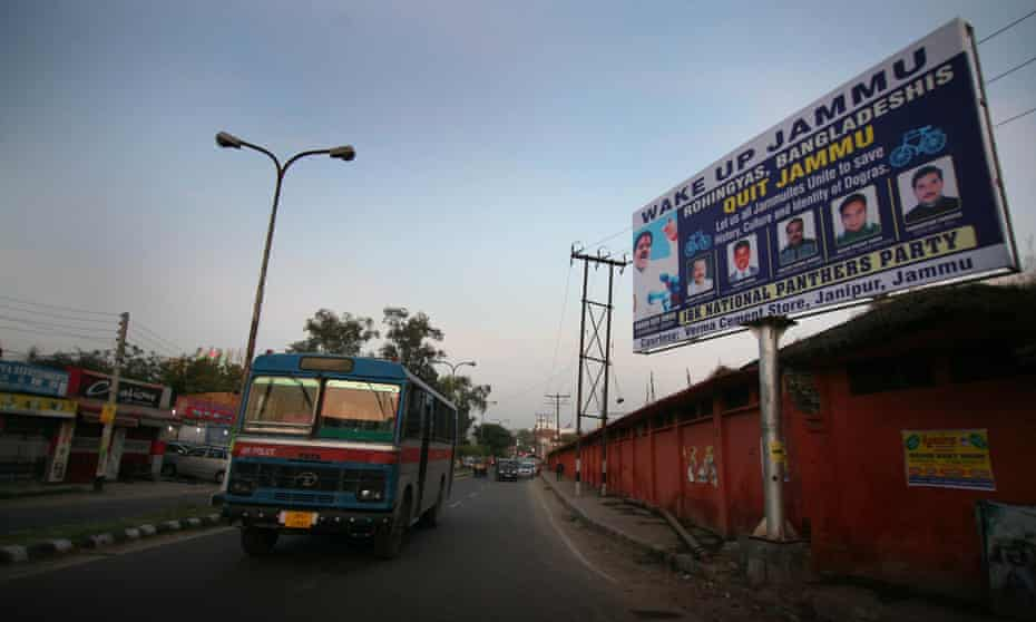 A roadside billboard in Jammu warns refugees to leave the north Indian city