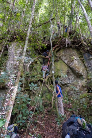 The team climbs treacherous terrain.