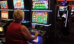 Woman plays a poker machine