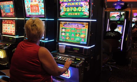 Gamblers playing poker machines, known as pokies.