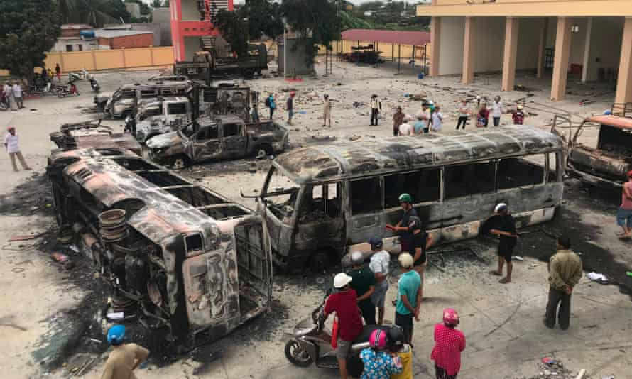 Charred buses lie scattered in central Binh Thuan province, Vietnam, on Tuesday following Sunday protests.