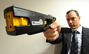 Robert Nioa, displays a new generation stun gun manufactured by his company.