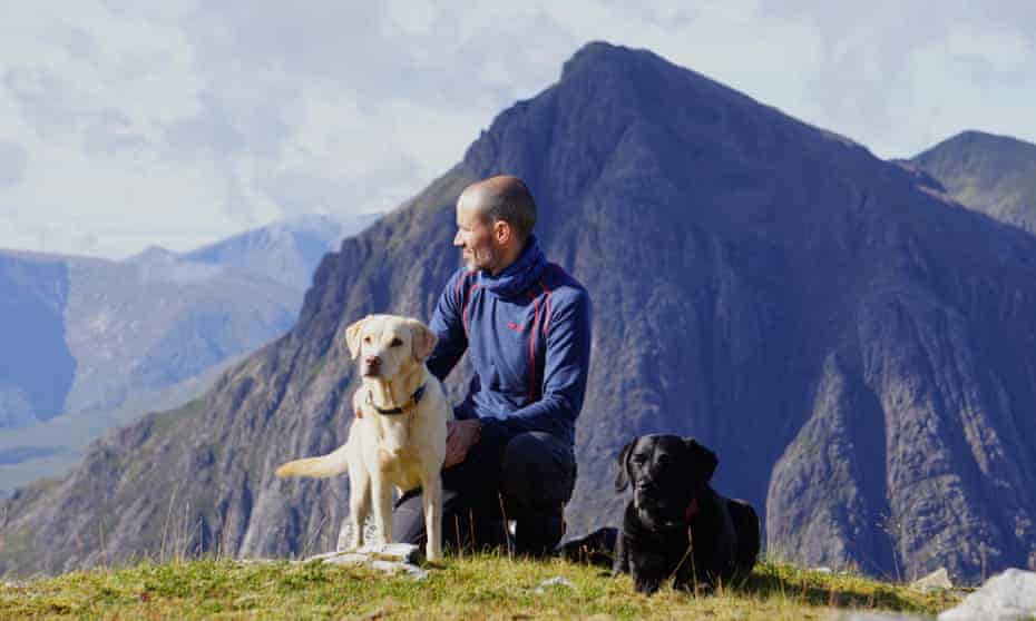 Andrew Cotter and his dogs Mabel and Olive climbing near Glencoe