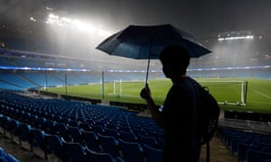 One fan has come prepared, with heavy rain putting the match in doubt.