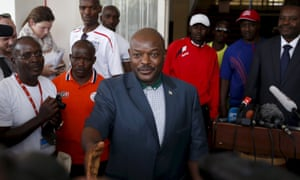 Burundi's president Pierre Nkurunziza greets journalists in Bujumbura in May.