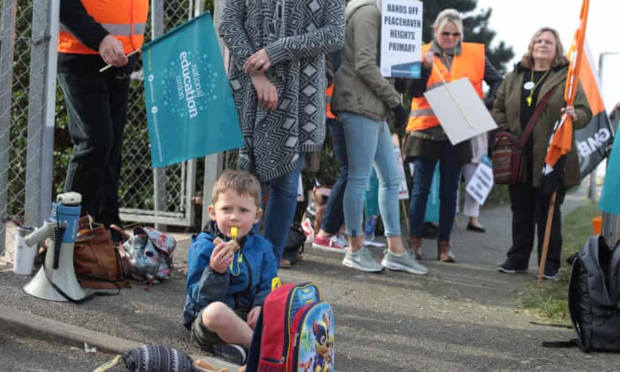 A child eats a sandwich during protests in Peacehaven