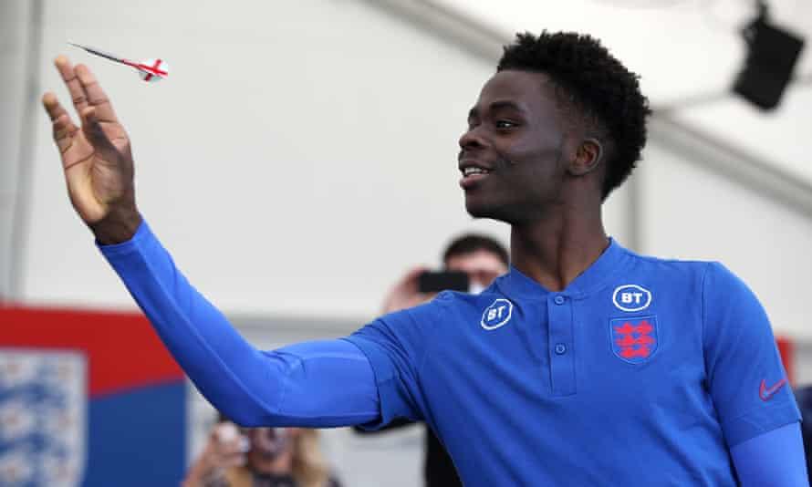 Bukayo Saka plays darts at St George's Park and hopes to find his range for England at Euro 2020.