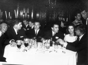 The East End gangster Ronnie Kray sits on Keeler's righthand side at a nightclub