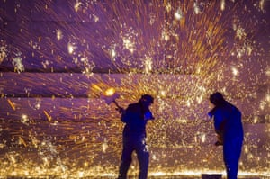 Hebei province, ChinaMolten iron sprayed to create spark art performance to promote local tourism