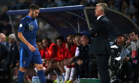 Karim Benzema, left, walks past Didier Deschamps during France's match against Georgia in Tbilisi in September 2013.