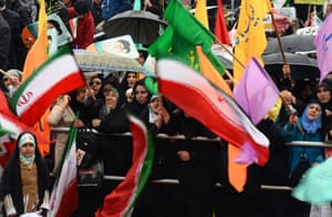 Colourful flags and banners at a rally in Azadi Square