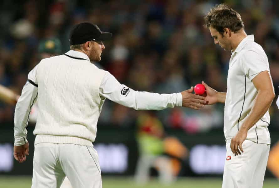 New Zealand's captain Brendon McCallum, left, hands the pink ball to Doug Bracewell during the Adelaide Test against Australia.